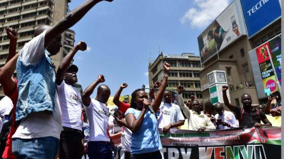 "Civil rights activists demonstrate on February 5, 2018 in the streets of Nairobi to protest against the shutdown of three major TV channels to stop them from broadcasting  a ""swearing-in"" of opposition leader on January 30. Kenyan police detained three government critics in four days and blocked three major TV channels to stop them from broadcasting on January 30 a ""swearing-in"" of opposition leader as the ""people"