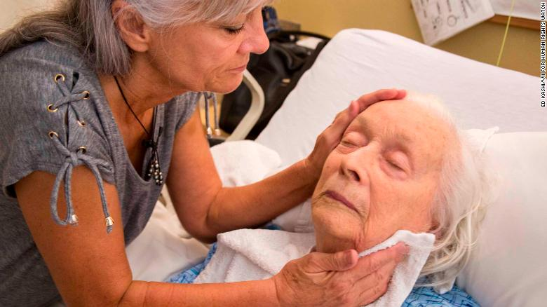 Laurel Cline visits her mother, Lenora, in a Los Angeles nursing home. She said she had to persuade staff to stop giving her mother antipsychotic drugs.