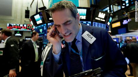 Trader Gregory Rowe works on the floor of the New York Stock Exchange, Monday, Feb. 5, 2018. Stock markets around the world took another pummeling Monday as investors continued to fret over rising U.S. bond yields. (AP Photo/Richard Drew)