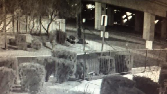 A surveillance camera captured footage of this homeless man sleeping on the sidewalk on February 2. Later a man gets out of an SUV and shoots him.