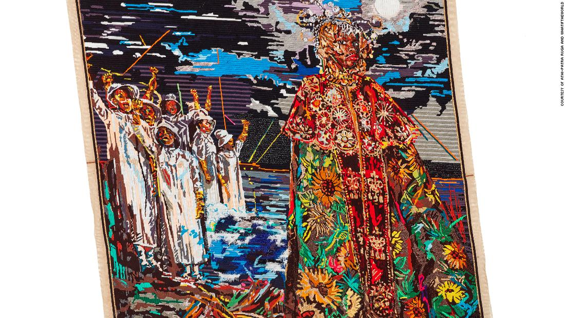 "The bulk of the exhibition is made up of hand-embroidered tapestries. By creating quasi-historical artifacts, such as maps, portraits and tapestries showing mythological events, Ruga is forming his own nation, Azania. This piece is entitled ""Somagwaza: a Queen's Herald."""