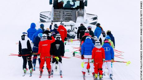 Teams go to inspects the course at Lake Louise.