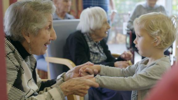Fay Garcia, 90, visits with a child from her care home