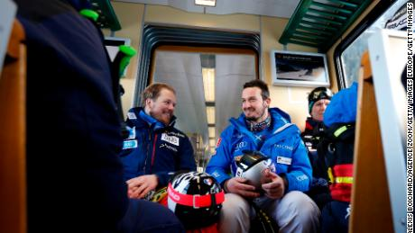 Jansrud (left) shares a joke with Dominik Paris of Italy.