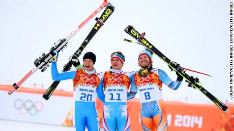 Silver medalist Christof Innerhofer of Italy (left), gold medalist Matthias Mayer of Austria (center) and bronze medalist Kjetil Jansrud of Norway (right) celebrate at Sochi 2014.