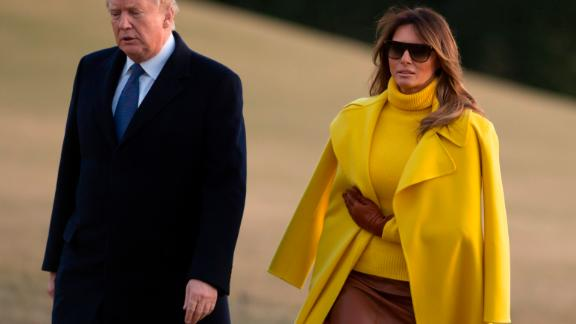 US President Donald Trump and First Lady Melania Trump walk across the South Lawn upon arrival on Marine One at the White House in Washington, DC, February 5, 2018, following a tripl to Ohio.
