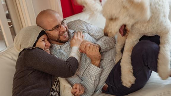 Layla Barakat, left, and her son, Farris Barakat and dog, AJ, hang out on the couch at the Barakat household in Raleigh, North Carolina on Wednesday, December, 20, 2017. Three years ago, Layla