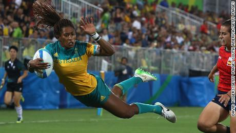 RIO DE JANEIRO, BRAZIL - AUGUST 07:  Ellia Green of Australia dives in to score a try against Patricia Garcia of Spain during the Women's Quarter-final 1 rugby match on Day 2 of the Rio 2016 Olympic Games at Deodoro Stadium on August 7, 2016 in Rio de Janeiro, Brazil.  (Photo by David Rogers/Getty Images)