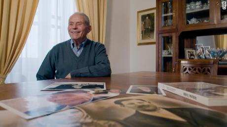 Tonino, the son of the world's first man to live to 110 years old, reflects on pictures of his late father.