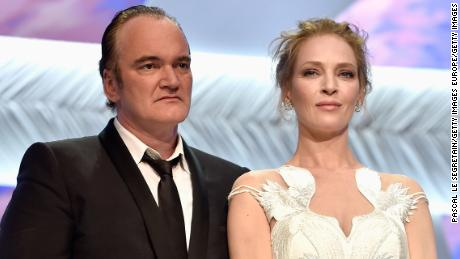 CANNES, FRANCE - MAY 24:  Director Quentin Tarantino and actress Uma Thurman appear on stage to give the Palme d'Or award during the Closing Ceremony at the 67th Annual Cannes Film Festival on May 24, 2014 in Cannes, France.  (Photo by Pascal Le Segretain/Getty Images)