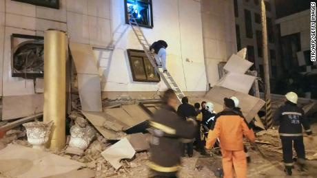 Rescue workers search through rubble outside the Marshal Hotel in Hualien early Wednesday.
