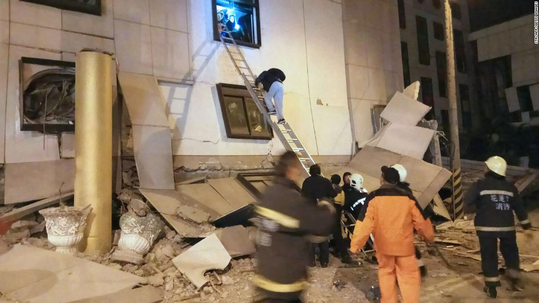 Emergency responders carry out search-and-rescue operations amid rubble outside the Marshal Hotel.