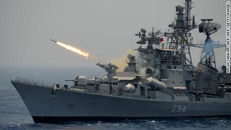 A rocket is fired from the Indian Navy destroyer ship INS Ranvir during an exercise drill in the Bay of Bengal, April 18, 2017.