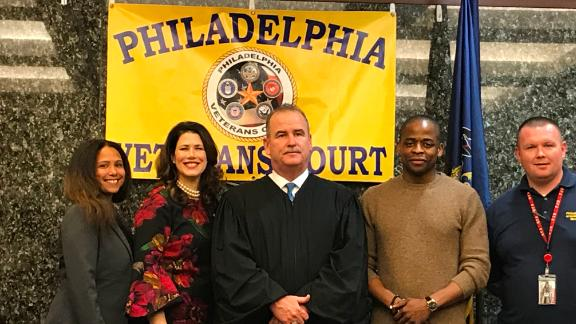 Former West Wing castmates Melissa Fitzgerald and Dule Hill attend veterans treatment court graduation in the Philadelphia courtroom of Judge Patrick Dugan.