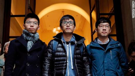 "Pro-democracy activists, from left, Joshua Wong, Alex Chow and Nathan Law, walk out from the Court of Final Appeal in Hong Kong, Tuesday, Feb. 6, 2018. Hong Kong's highest court on Tuesday overturned prison sentences for three young pro-democracy activists convicted for their roles in kicking off 2014's ""Umbrella Movement"" protests in the semiautonomous Chinese city. (AP Photo/Vincent Yu)"