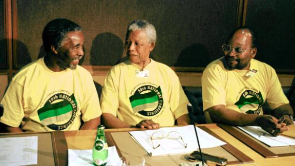 President Mandela is flanked by Zuma and Deputy President Thabo Mbeki, left, at the ANC
