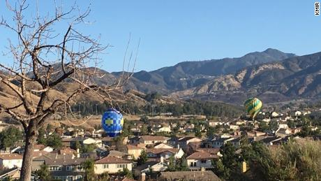 San Bernardino County Sheriff's deputies spotted the hot air balloons flying just above homes.