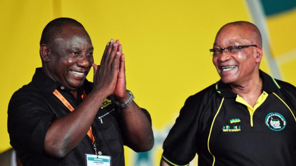 Zuma looks at Cyril Ramaphosa after Ramaphosa was elected deputy president of the ANC in December 2012. Zuma was re-elected as the party