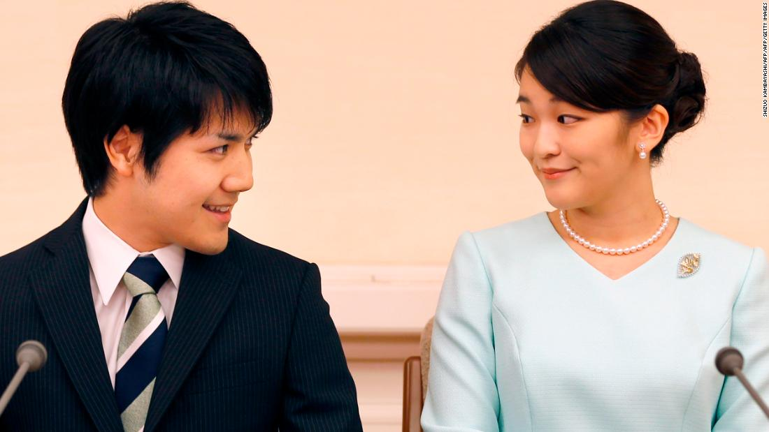 Princess Mako, right, the eldest daughter of Prince Akishino and Princess Kiko, and her fiancé Kei Komuro smile during a news conference to announce their engagement on September 3, 2017.