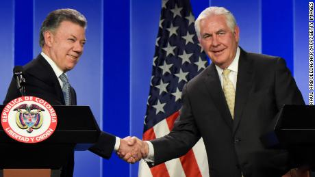 Colombian President Juan Manuel Santos (L) shakes hands at press conference with US Secretary of State Rex Tillerson, in Bogota, on February 6, 2018. / AFP PHOTO / Raul ARBOLEDA        (Photo credit should read RAUL ARBOLEDA/AFP/Getty Images)