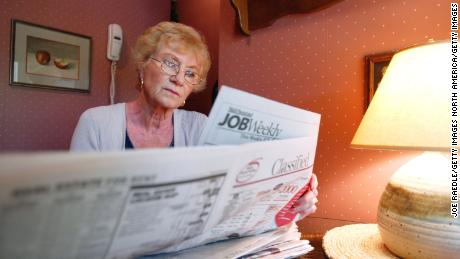 MARGATE, FLORIDA - JULY 26:  Anita Dante, in her late 60's, searches for a job in a local newspaper's classified section at her home July 26, 2002 in Margate, Florida. After working for most of her life, Dante had planned on retiring, but her plans have changed. A financial advisor explained that she should be more aggressive in her investments approximately 2 1/2 years ago. Dante has since lost most of her retirement nest egg and must now get a job to continue to support herself. Like Anita Dante, many people around the U.S., who are reaching retirement age, are having to rethink their strategy with investments plummeting and 401 (k) saving plans shrinking.  (Photo by Joe Raedle/Getty Images)