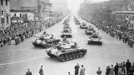 Army tanks move along Pennsylvania Avenue in the inaugural parade for President Dwight D. Eisenhower on January 21, 1953.