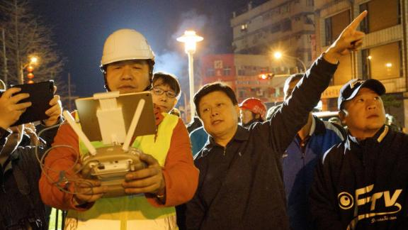 Rescue workers check the area affected by the quake in Hualien.
