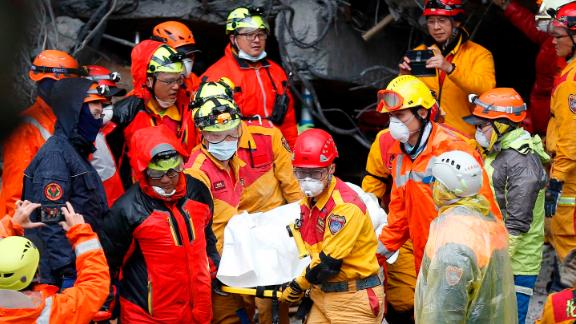 Emergency workers recover a victim from a destroyed building in Hualien on February 7.