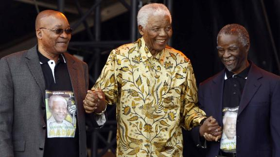 From left, Zuma, Mandela and Mbeki arrive on stage for Mandela's 90th birthday celebration in August 2008.