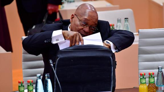 Zuma talks on his cell phone during a G20 session in Hamburg, Germany, in July 2017. A month later, he survived an ouster attempt in his country's National Assembly. A motion of no-confidence was defeated by 198 votes to 177.