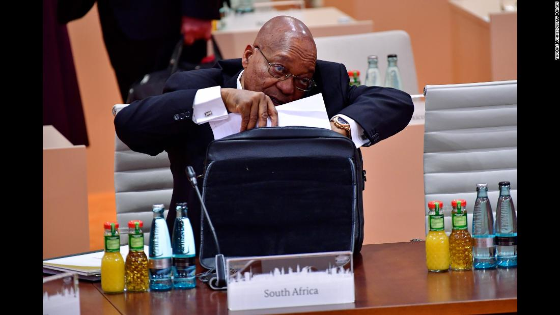 "Zuma talks on his cell phone during a G20 session in Hamburg, Germany, in July 2017. A month later, <a href=""http://www.cnn.com/2017/08/08/africa/zuma-south-africa-vote/index.html"" target=""_blank"">he survived an ouster attempt</a> in his country's National Assembly. A motion of no-confidence was defeated by 198 votes to 177."