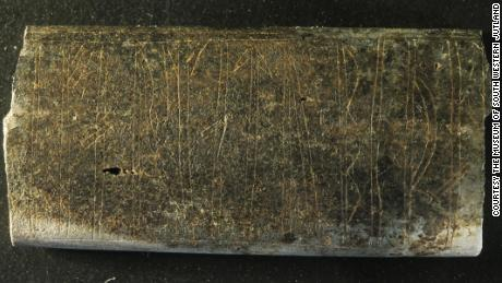 A fragment of a plate with a yet undeciphered inscription