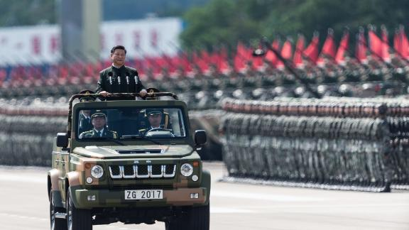 China's President Xi Jinping inspects People's Liberation Army soldiers at a barracks in Hong Kong on June 30, 2017.