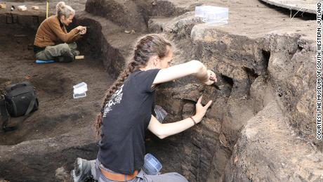 Archaeologists inspect the geological layers at the Ribe excavation site