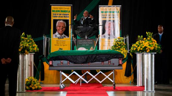 Zuma sings during a send-off ceremony for former President Nelson Mandela, who died in December 2013 at the age of 95.