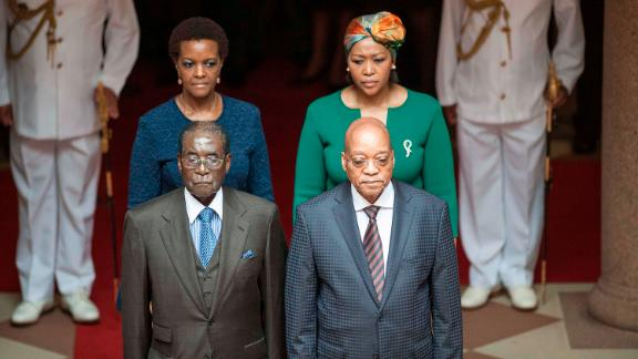 Zuma and his wife Thobeka Mabhija, right, pose with then Zimbabwean President Robert Mugabe and his wife, Grace, as they meet in Pretoria in April 2015.