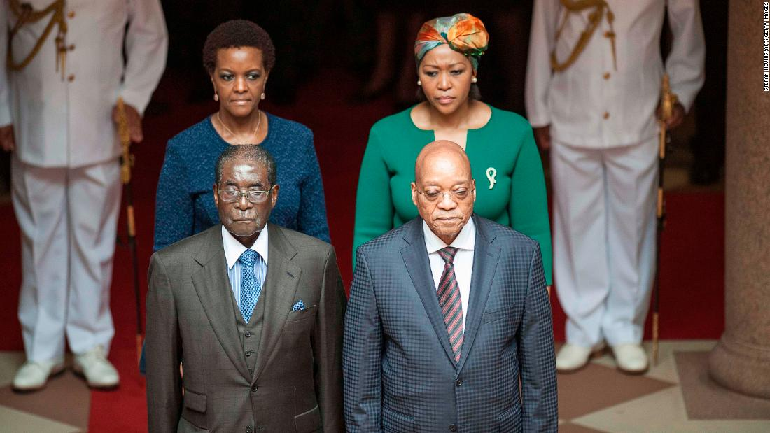 "Zuma and his wife Thobeka Mabhija, right, pose with then Zimbabwean President <a href=""http://edition.cnn.com/2013/07/31/africa/gallery/robert-mugabe/index.html"" target=""_blank"">Robert Mugabe</a> and his wife, Grace, as they meet in Pretoria in April 2015."