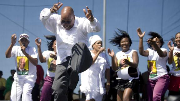 Zuma sings and dances after a speech at a rally in February 2009. Zuma was elected as South Africa