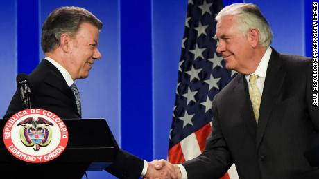 Colombian President Juan Manuel Santos (L) shakes hands at a press conference with US Secretary of State Rex Tillerson, in Bogota, on February 6, 2018. / AFP PHOTO / Raul ARBOLEDA        (Photo credit should read RAUL ARBOLEDA/AFP/Getty Images)