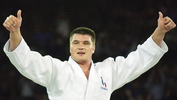SYDNEY, AUSTRALIA:  David Douillet of France celebrates his gold medal victory in the Olympic men's heavyweight over 100kg final against Shinichi Shinohara of Japan, 22 September 2000 at the Sydney 2000 Olympic Games. Douillet, who won the bronze medal in the 1992 Barcelona Games and the gold at the 1996 Atlanta Games was also the World heavyweight champion in 1993, '95 and '96. AFP PHOTO/KIM Jae-Hwan (Photo credit should read KIM JAE-HWAN/AFP/Getty Images)