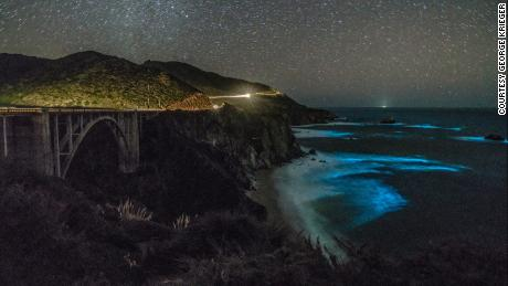 Phytoplankton concentrations in the waters below Bixby Creek Bridge illuminate the darkened waters.