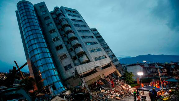 Rescue services search for people at a damaged building in Hualien, Taiwan, on Wednesday, February 7. A 6.4 magnitude earthquake was recorded about 21 kilometers (13 miles) north of Hualien late Tuesday. Several people were killed and many were injured.