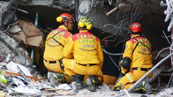 A crew searches for survivors believed to be trapped inside the collapsed Marshal Hotel in Hualien.