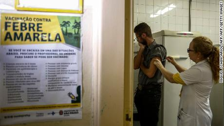 A man gets a vaccine against yellow fever at an outpatient clinic in Sao Paulo, Brazil, on January 12, 2018.  Brazil stepped up prevention measures against yellow fever, especially in Sao Paulo, where several deaths from the disease have been registered in the past few days. / AFP PHOTO / Miguel SCHINCARIOLMIGUEL SCHINCARIOL/AFP/Getty Images