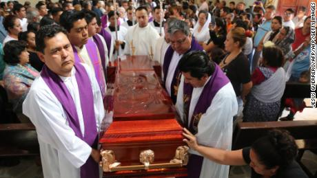 Priests carry Catholic priest Germain Muniz's coffin during his funeral in the community of Apango, Guerrero state, Mexico, on February 6, 2018.  Two priests and an elementary school teacher were killed on Monday in Guerrero, in an ambush in which four other people were injured. / AFP PHOTO / JESUS GUERRERO        (Photo credit should read JESUS GUERRERO/AFP/Getty Images)
