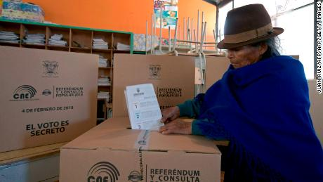 A native woman from Cangahua, northeast of Quito casts her vote at a polling station set at a school during a referendum called by President Lenin Moreno on February 4, 2018. Ecuadoreans decide the political fate of former president Rafael Correa Sunday in a referendum called by his successor turned staunched opponent and expected to prevent him from returning to power. / AFP PHOTO / Juan Ruiz        (Photo credit should read JUAN RUIZ/AFP/Getty Images)
