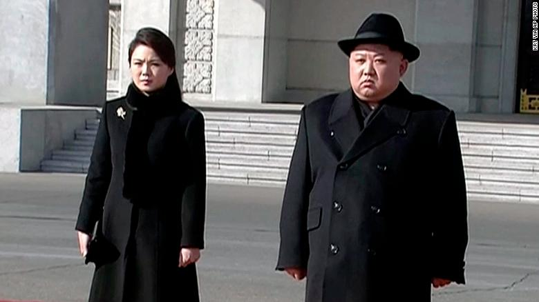North Korean leader Kim Jong Un, right, and his wife Ri Sol Ju arrive at the parade
