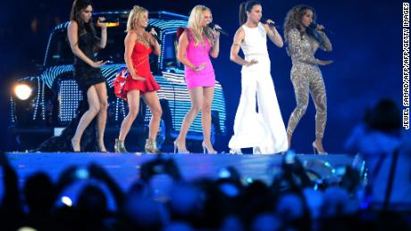 "(FILES) In this file photo taken on August 12, 2012 Spice Girls, Victoria Beckham, Geri Horner, Emma Bunton, Melanie Chisholm and Melanie Brown, perform at the Olympic stadium during the closing ceremony of the 2012 London Olympic Games in London on August 12, 2012. The Spice Girls got back together on February 3, 2018 for the first time since 2012 and announced plans to explore ""incredible new opportunities"" in the future. / AFP PHOTO / Jewel SAMADJEWEL SAMAD/AFP/Getty Images"