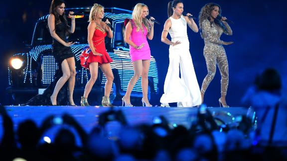 """(FILES) In this file photo taken on August 12, 2012 Spice Girls, Victoria Beckham, Geri Horner, Emma Bunton, Melanie Chisholm and Melanie Brown, perform at the Olympic stadium during the closing ceremony of the 2012 London Olympic Games in London on August 12, 2012. The Spice Girls got back together on February 3, 2018 for the first time since 2012 and announced plans to explore """"incredible new opportunities"""" in the future. / AFP PHOTO / Jewel SAMADJEWEL SAMAD/AFP/Getty Images"""