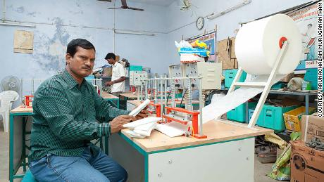 "India's ""menstrual man,"" Arunachalam Muruganantham, shows off the $1,012 machine he designed to produce affordable sanitary pads."